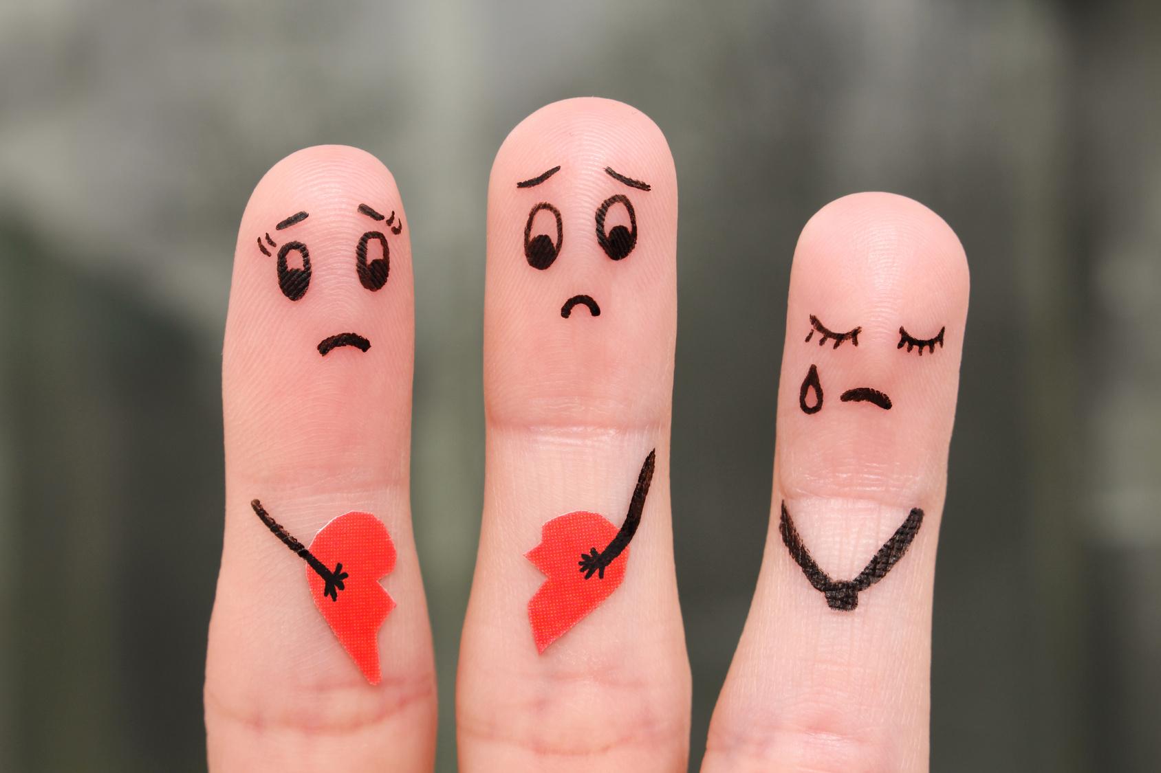 Finger art of family during quarrel. The concept of parents quarrel, child was upset.